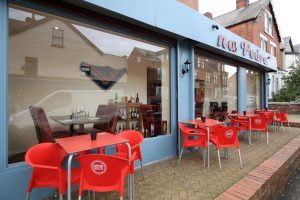 Seating and shop from at na Pedra, Portuguese restaurant